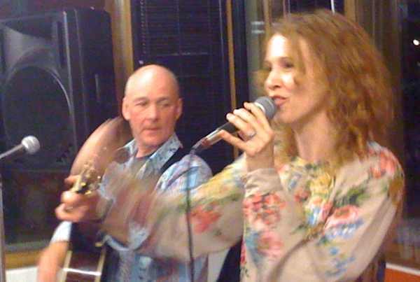 The teacher and the singer play at the end of term party